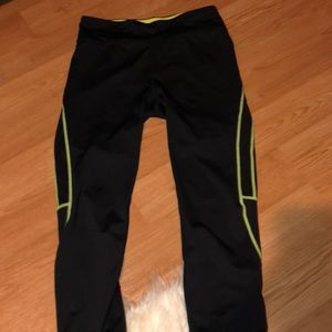 Black and neon green work out leggings.